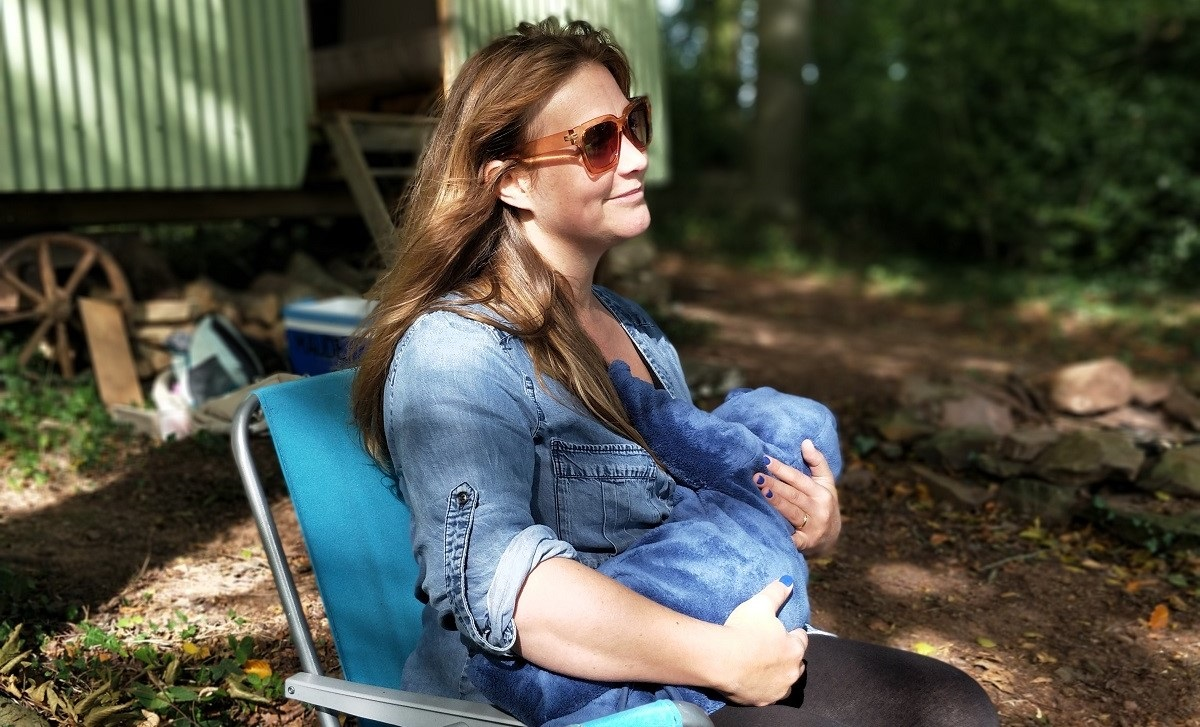 Woman breastfeeding outdoors