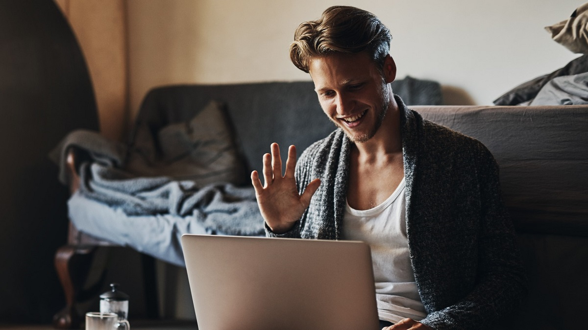 Young man in isolation connecting with friends online