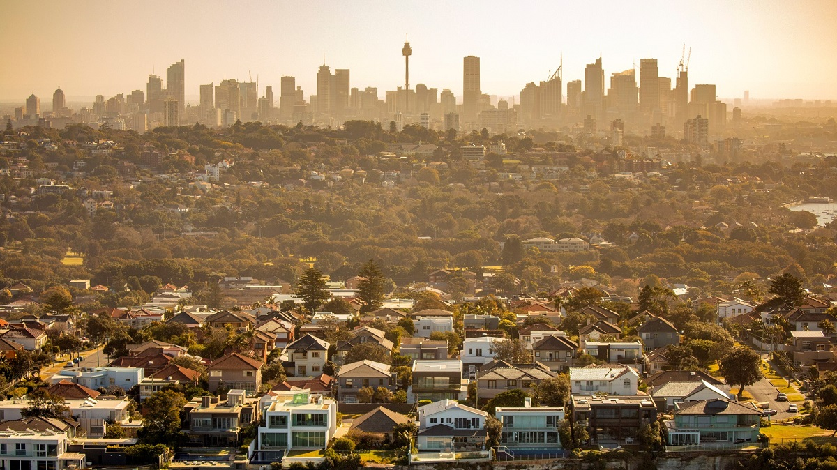 Aerial photography of Sydney skyline cityscape, suburb and houses on costal sea cliff